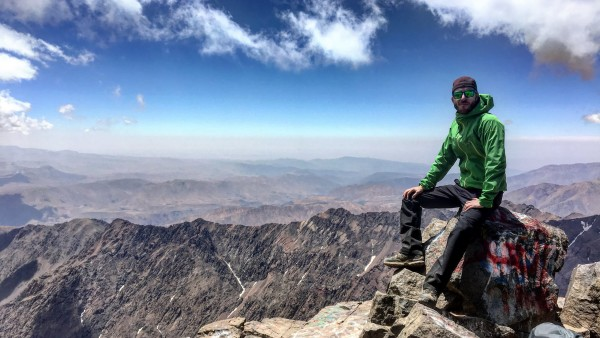 Sitting on the peak of Mt. Toubkal.